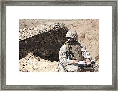A U.s. Marine Communicates With Close Framed Print by Stocktrek Images