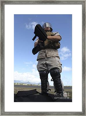 A U.s. Marine Dons Riot Gear For Drills Framed Print by Stocktrek Images