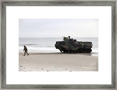 A U.s. Marine Guides An Amphibious Framed Print by Stocktrek Images