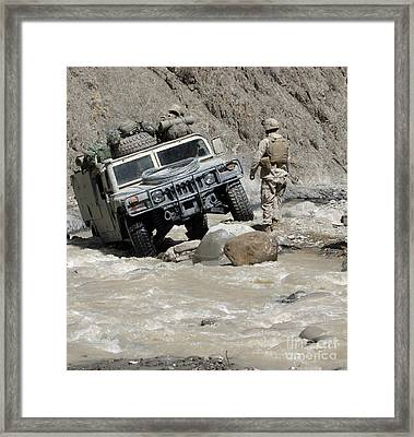 A U.s. Marine Guiding The Driver Framed Print by Stocktrek Images