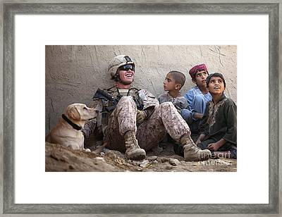 A U.s. Marine Jokes With Afghan Framed Print by Stocktrek Images