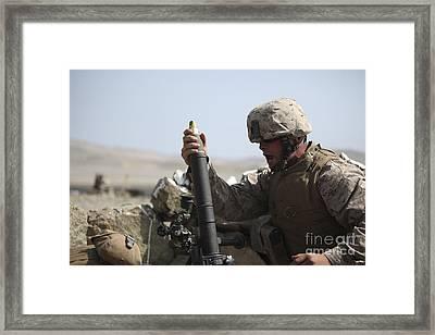 A U.s. Marine Loads A Mortar Framed Print by Stocktrek Images