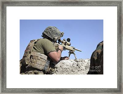 A U.s. Marine Looks Through The Scope Framed Print by Stocktrek Images