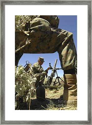 A U.s. Marine Mortarman Trains On An Framed Print by Stocktrek Images