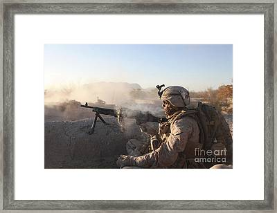 A U.s. Marine Provides Support By Fire Framed Print by Stocktrek Images
