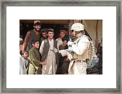 A U.s. Marine Talks With Afghans Framed Print by Everett
