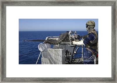 A U.s. Navy Gunners Mate Firing Framed Print by Stocktrek Images