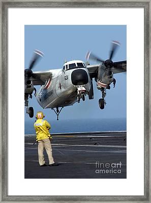 A U.s. Navy Officer Observes A C-2a Framed Print by Stocktrek Images