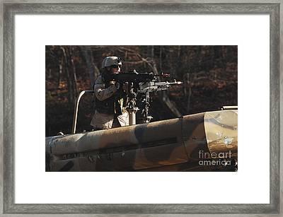A U.s. Navy Sailor Mans The 240gs Port Framed Print by Stocktrek Images