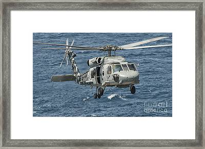 A Us Navy Sh-60f Seahawk Flying Framed Print by Giovanni Colla