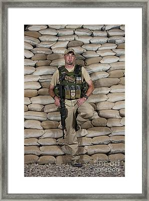 A U.s. Police Officer Contractor Leans Framed Print by Terry Moore