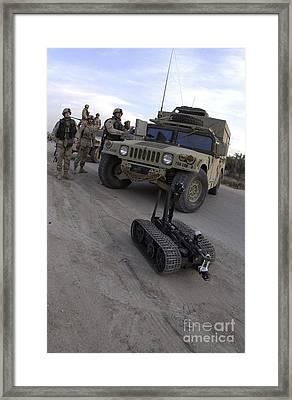A U.s. Soldier Deploys A Remotely Framed Print