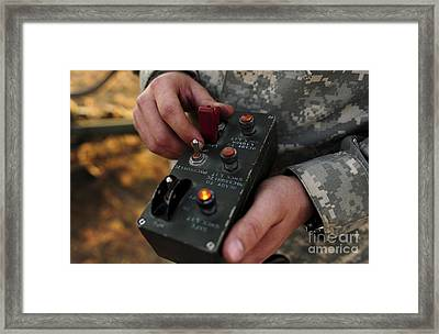 A U.s. Soldier Hits The Button Framed Print by Stocktrek Images