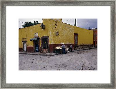 A Vendor Selling Food On A Street Framed Print by Gina Martin