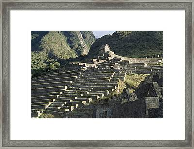 A View Of Stone Terraces At Machu Framed Print by David Evans