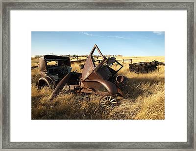 A Vintage Car Rusts In A Prairie Framed Print by Pete Ryan