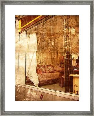 A Vintage Grunge Parisian Shop Framed Print by Jennifer Holcombe