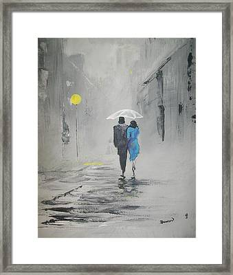 A Walk In The Rain Framed Print by Raymond Doward