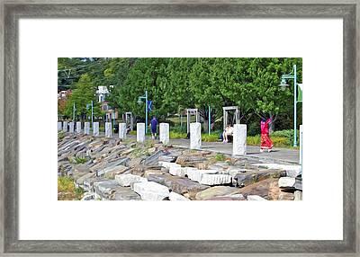 A Walk On The Pier Framed Print