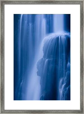 A Waterfall Splashes Off Of A Large Framed Print