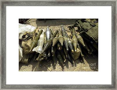 A Weapons Cache Of Chinese Rocket Framed Print by Stocktrek Images