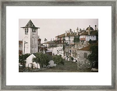 A White Bell Tower Stands Bright Framed Print