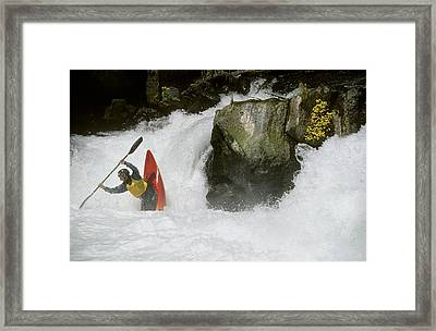 A Whitewater Kayaker Plays At The Base Framed Print