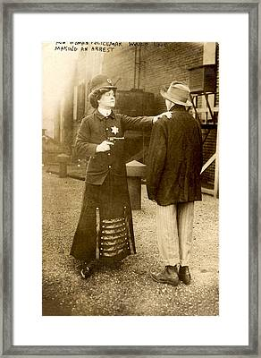 A Woman Behaving As A Policeman Framed Print