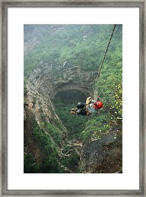 A Woman Climbs Out Of Tawi Attair Framed Print