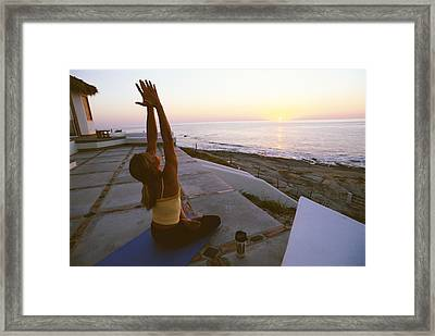 A Woman Does Yoga In Front Framed Print by Jimmy Chin