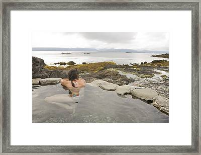 A Woman Enjoys A Hot Spring Framed Print by Taylor S. Kennedy