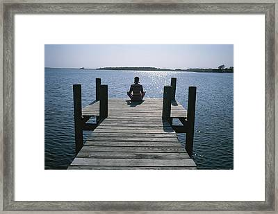 A Woman In A Yoga Pose At The End Framed Print by Taylor S. Kennedy