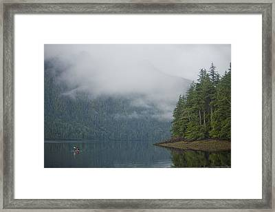 A Woman Kayaks Along A Quiet Inlet Framed Print by Taylor S. Kennedy
