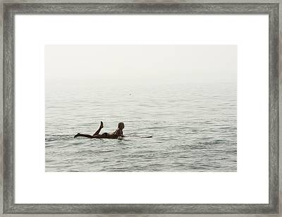 A Woman Rests On Her Surfboard Waiting Framed Print by Tim Davis