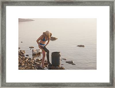 A Woman Smears Therapeutic Dead Sea Mud Framed Print by Taylor S. Kennedy