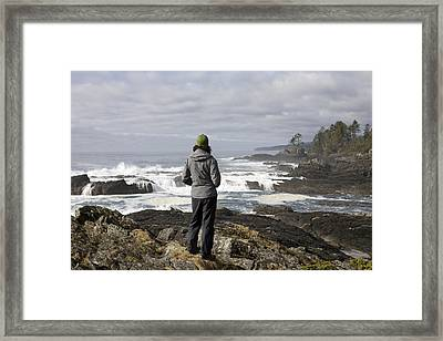 A Woman Stands On A Rocky Outcropping Framed Print by Taylor S. Kennedy