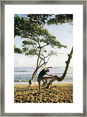 A Woman Stretches On A Beach Framed Print by Skip Brown