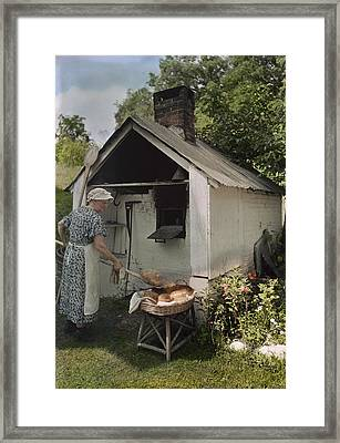 A Woman Takes Bread From An Outdoor Framed Print