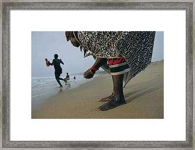 A Woman Training To Be A Healer Gathers Framed Print by Chris Johns