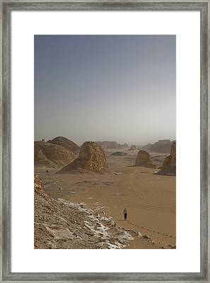 A Woman Walks Down A Sand Dune Framed Print by Taylor S. Kennedy