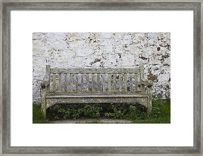 A Wooden Bench With Peeling Paint Framed Print by John Short