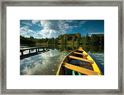 A Wooden Boat On A Lake In Suwalki Lake District Framed Print by Slawek Staszczuk