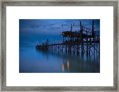 A Wooden Pier With Lights On It At Framed Print by David DuChemin