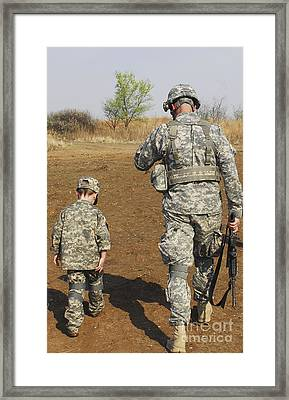 A Young Boy Joins His Squad Leader Framed Print by Stocktrek Images