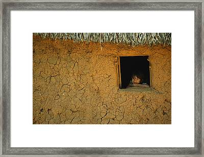A Young Girl Looks Dreamily Framed Print by Kenneth Garrett