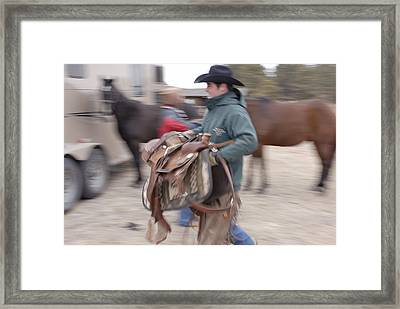 A Young Rancher Lifts A Framed Print by Joel Sartore