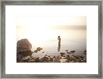 A Young Woman Wades Into The Dead Sea Framed Print by Taylor S. Kennedy
