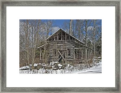 Abandoned House In Snow Framed Print by Susan Leggett