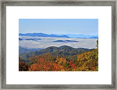 Above The Clouds Framed Print by Susan Leggett