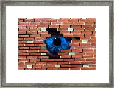 Abstract Of Eye Looking Through Hole In Brick Wall Framed Print by Mehau Kulyk